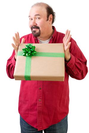 three quarter: Three quarter body portrait of generous balding man giving or receiving present, white background Stock Photo