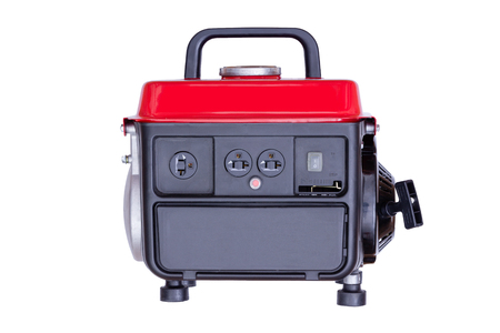 petrol powered: Modern red petrol powered electrical generator viewed from side, white background