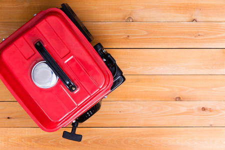 Red petrol driven generator viewed from above on wooden background with copy space Stock Photo