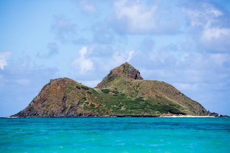 Mokulua island sitting on the turqousie waters of Pacific Ocean accross from Lanikai Beach, Pillbox hike
