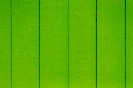 Bright lime green wooden background texture of parallel vertical timber planks or boards in a full frame view Stock Photo