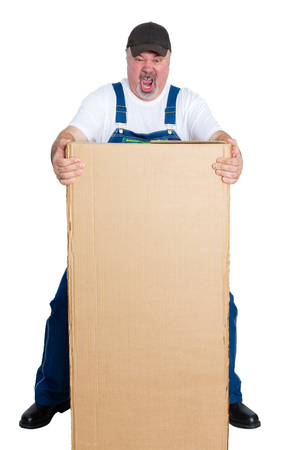 Delivery man lifting large heavy package against white background