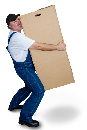 Delivery man lifting heavy cardboard box against white background Stock Photo