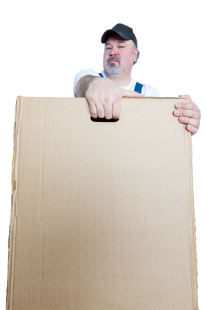 Man carrying large cardboard box against white background