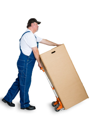 Mal worker delivering large cardboard box using cart against white background
