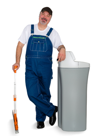 Proud confident water softener installer standing leaning on the new tank with a friendly happy smile isolated on white Stock Photo - 96173528