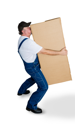 Delivery man carrying heavy cardboard box against white background