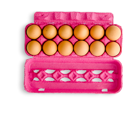Dozen eggs in pink recycled paper carton box viewed from above and isolated on white