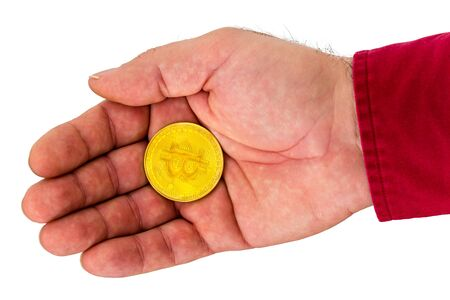 Close up view of cryptocurrency coin in hand against white background