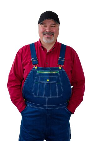 Cheerful farm worker wearing dungarees standing against white background
