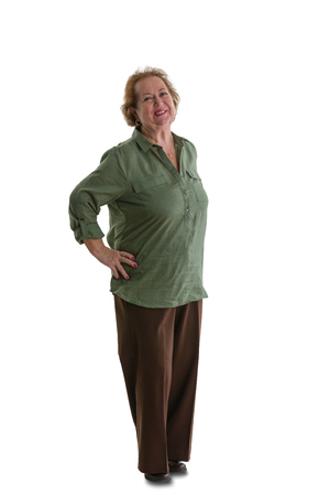 Portrait of cheerful senior lady standing against white background