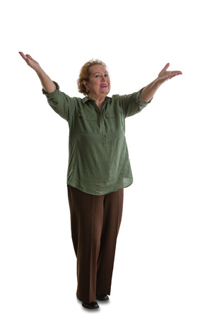 Cheerful grandmother standing with welcoming gesture against white background