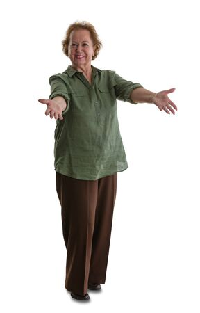 Portrait of senior woman doing welcoming gesture while standing against white background Stock Photo