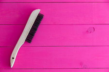 Cleaning brush against pink background with copy space
