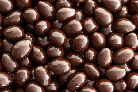 Macro background texture of dark chocolate covered almonds Stock fotó