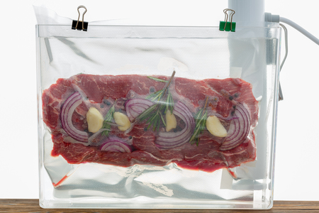 Portion of flat iron beef steak sous-vide 写真素材