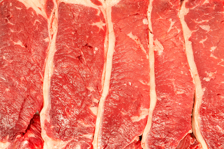 Full frame texture of raw flat iron steaks Фото со стока