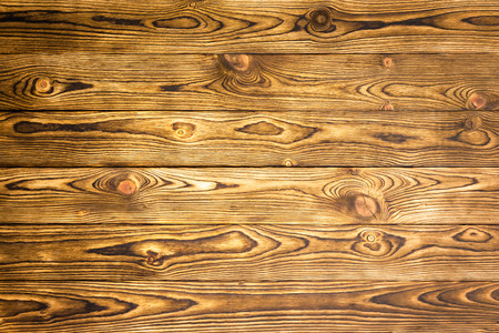 Rustic wood background texture of parallel boards with a decorative woodgrain pattern for use as a template in a full frame view