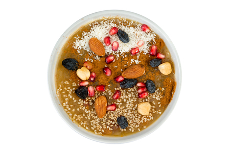 Overhead view of delicious asure bowl filled with nuts and fruit. Фото со стока