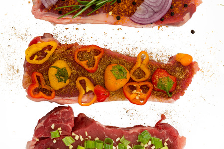 Closeup view of meats deliciously seasoned with colorful vegetables gochujang and black pepper, isolated on white Фото со стока