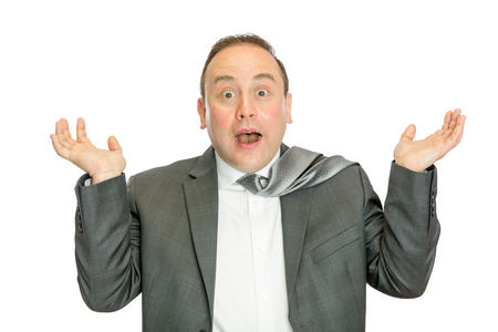 A portrait of a funny, surprised business man in suit shrugging with a white  and copy space.