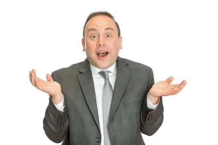 A portrait of a funny, comical business man in suit shrugging with a white  and copy space.