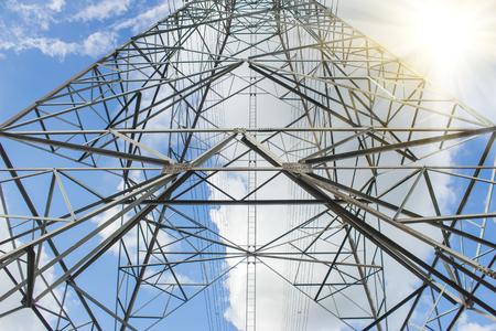 electricity generation: Electric Transmission Tower.electricity transmission pylon silhouetted against blue sky at dusk
