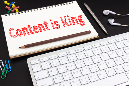 businees: Word text Content is king on white paper on office table  business concept