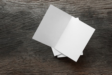 Blank portrait mock-up paper. brochure magazine isolated on brown wooden table, changeable background  whit