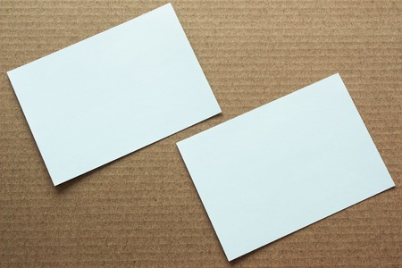 Blank portrait mock-up paper. brochure magazine isolated on brown background, changeable background  white paper template isolated