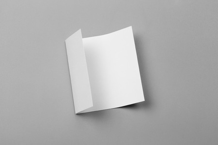 Blank portrait mock-up paper. brochure magazine isolated on gray, changeable background  white paper isolated on gray Stockfoto