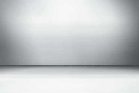 soft gray studio room background, grey floor backdrop with spotlight Stockfoto