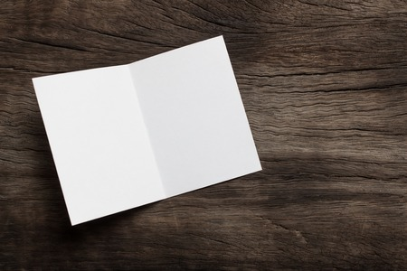 Blank portrait mock-up paper. brochure magazine isolated on brown wooden table, changeable background  white paper isolated on wood