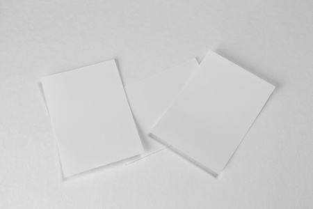 Blank portrait A4. brochure magazine isolated on gray, changeable background / white paper isolated on white wall. 写真素材
