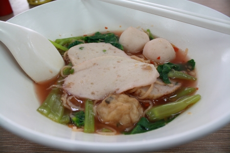 fish ball noodle and soup in a big cup photo