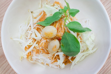 Thai rice vermicelli served with curry,it is local Thai food photo