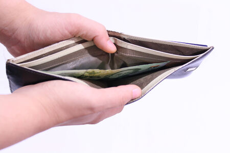 billfold: Male hands is opening a billfold with less money Stock Photo
