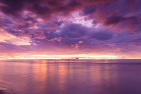 orange sunset: Prachuap Khiri Khan, Thailand-August 23,2015: Thai gulf sea in sunrise scene