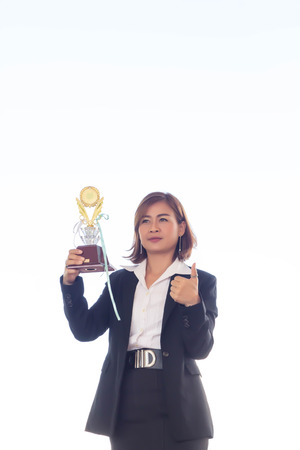Businesswoman holding award trophy for show their victory.