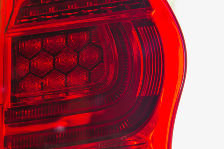 The tail lights of some modern innovative cars that change from ordinary tube to LED. Stock Photo