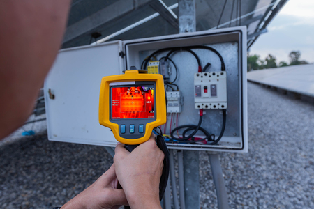 Thermoscan(thermal image camera), Industrial equipment used for checking the internal temperature of the machine for preventive maintenance, This is checking therminal DC fuse of solar panel. 版權商用圖片