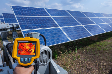 Thermoscan(thermal image camera), Industrial equipment used for checking the internal temperature of the machine for preventive maintenance, This is checking The motor for tracking sun of solar plant.