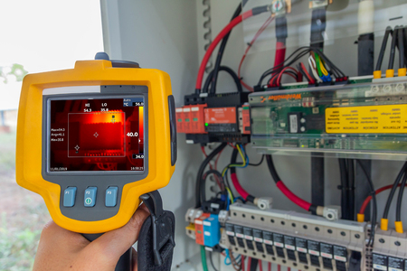 Thermoscan(thermal image camera), Industrial equipment used for checking the internal temperature of the machine for preventive maintenance, This is checking The power supply for tracking sun of solar plant.