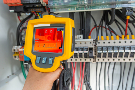 Thermoscan(thermal image camera), Industrial equipment used for checking the internal temperature of the machine for preventive maintenance, This is checking The terminal of the positive cable.