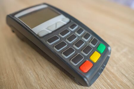 Credit card reader machine or credit card terminal EDC on wooden table, Electronic payment.