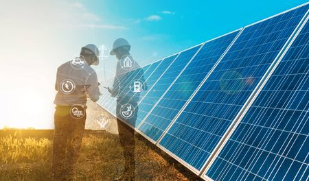 The solar farm(solar panel) with two engineers is diagnosing the production capacity, Alternative energy to conserve the world's energy, Photovoltaic module idea for clean energy production. Imagens