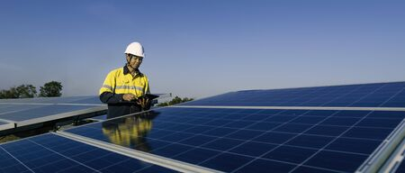 The solar farm(solar panel) with two engineers walk to check the operation of the system, Alternative energy to conserve the world's energy, Photovoltaic module idea for clean energy production.