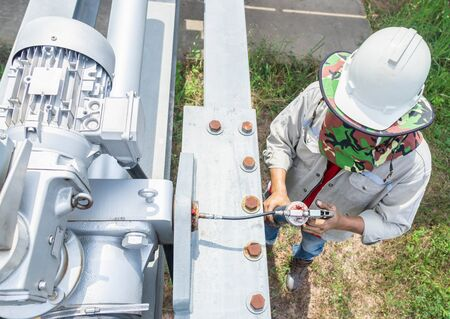 Expert technicians are preventive maintenance, of the control cabinet set, solar panel adjustment system according to the sun, Grease compression at steel joints for good lubrication. Reklamní fotografie