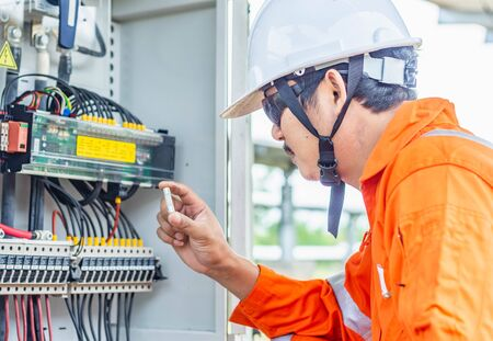 Engineer checking for abnormal solar power system operation And found that there is a lack of DC Fuse, resulting in a reduced capacity, Professional engineer concept about solar cell system.