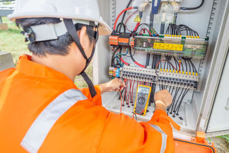 Engineers used a Multimeter for checking the performance of the solar panel to confirming systems working normally. Concepts professional engineer for the Solar cell power plant.